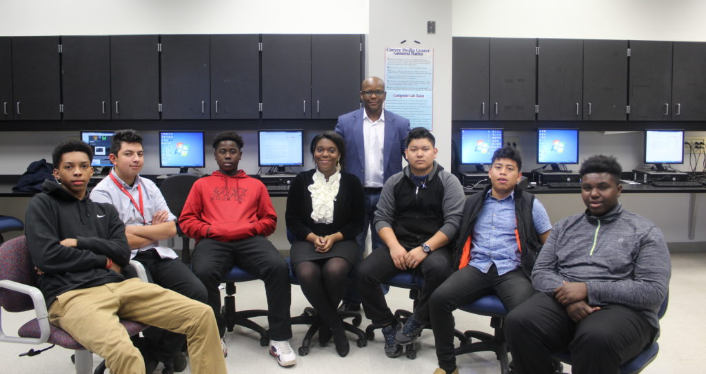 Howard Crosby, middle, and his Advanced Blogging studio art class. (Ariel Worthy, The Birmingham Times)