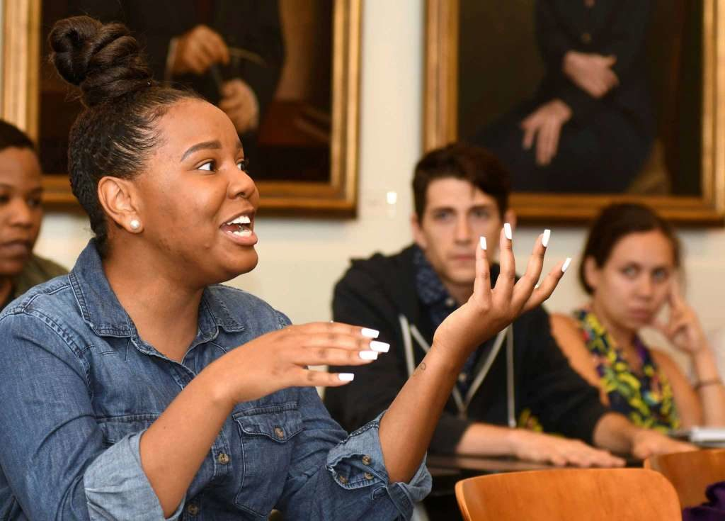 "In this Wednesday, Nov. 9, 2016 photo, Sarita Smith speaks during the ""Faith and Politics"" class at Emory University in Atlanta. The day after Donald Trump had won the presidency, graduate students talked of being shocked and wounded, fearful and horrified. (Associated Press)"