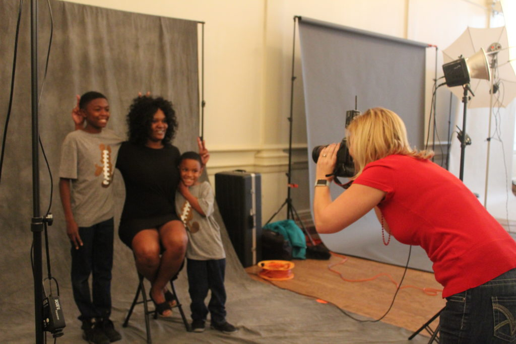 Angelle Morris and her sons Bryce and Braylon getting their photos taken by photographer Amber Ford at the YWCA Downtown for Hope Portrait Birmingham. (Provided photo)