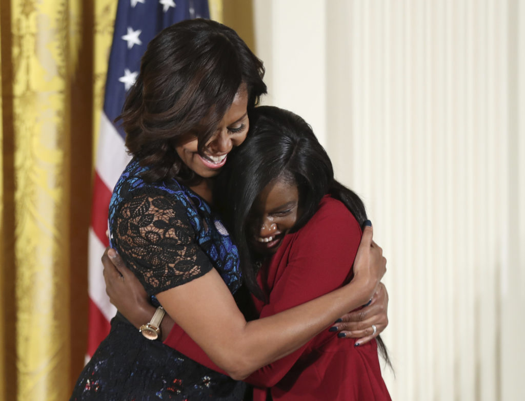 First lady Michelle Obama hugs Janasia Johnson, winner of the 2016 National Arts and Humanities Youth Program Award, during a ceremony in the East Room of the White House. (Manuel Balce Ceneta, Associated Press)