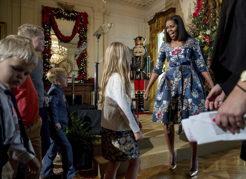 First lady Michelle Obama, right, greets children of military families in the East Room of the White House during a preview of the 2016 holiday decor (Andrew Harnik, Associated Press)