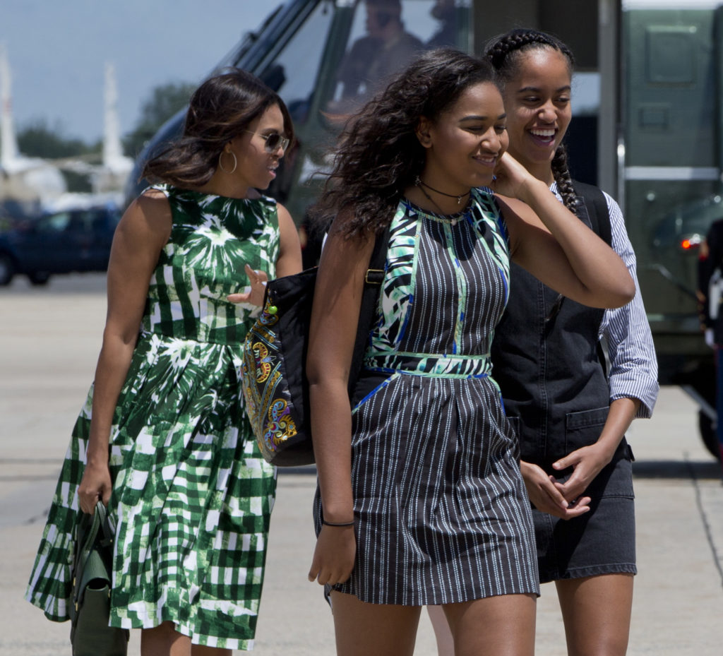 First Lady Michelle Obama leaves Marine One with her daughters Sasha and Malia. (Jacquelyn Martin, Associated Press)