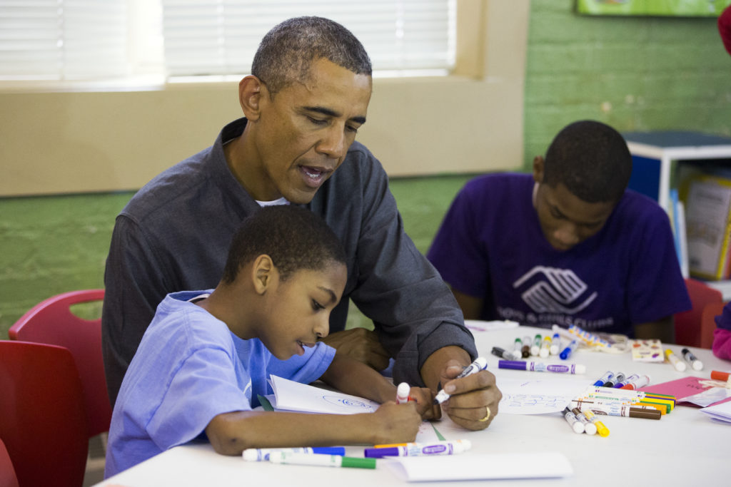 President Obama works with some children at the Boys & Girls Club of America.(Evan Vucci, Associated Press)