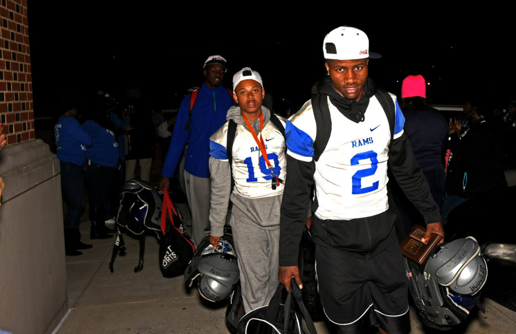 Senior quarterback Baniko Harley (2) carries his shoulder pads and his MVP trophy as he and his Ramsay teammates file into the Willie Scoggins Jr. Gymnasium after they defeated Opelika 21-16 in Jordan-Hare Stadium  to win the Class 6A Alabama High School Athletic Association state football championship on Friday, Dec. 2, 2016. (Solomon Crenshaw Jr., special to The Birmingham Times)