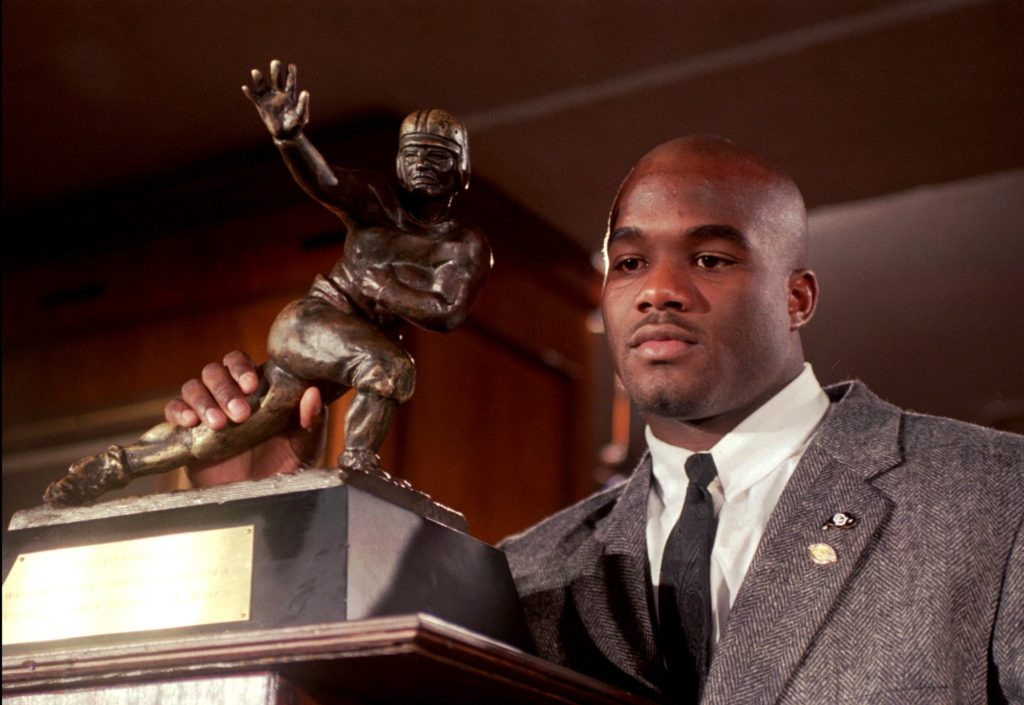 In this Dec. 10, 1994, file photo, Colorado's Rashaan Salaam poses with his 1994 Heisman Trophy at the Downtown Athletic Club in New York. Authorities say Rashaan Salaam has been found dead in a park in Boulder, Colo. The Boulder County coroner's office said Tuesday, Dec. 6, 2016, that it is still investigating the death of 42-year-old Salaam. (AP Photo/Adam Nadel, File)