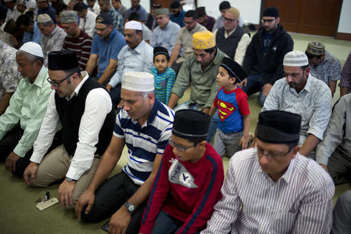 Wearing a t-shirt with a Superman logo on it, 4-year-old Atta Ul Arham attends a prayer service at the Ahmadiyya Muslim Community Mosque in Chino. (Associated Press photo)