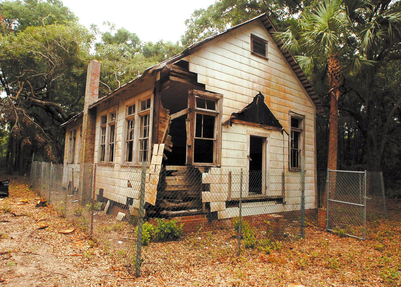 This undated photo shows a one-room schoolhouse built in the 1920s to teach black children on St. Simons Island, Ga. Preservationists saved the Harrington School from scheduled demolition in 2010 and since then have spent about $300,000 to stabilize its deteriorating frame and leaky roof. (Bobby Haven, Associated Press)