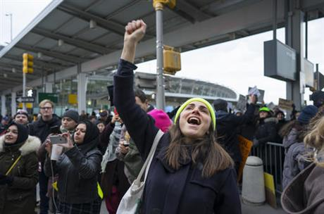 A protester raises her fist and shouts as she joins others assembled at John F. Kennedy International Airport in New York, Saturday, Jan. 28, 2017 after two Iraqi refugees were detained while trying to enter the country. On Friday, Jan. 27, President Donald Trump signed an executive order suspending all immigration from countries with terrorism concerns for 90 days. Countries included in the ban are Iraq, Syria, Iran, Sudan, Libya, Somalia and Yemen, which are all Muslim-majority nations. (Craig Ruttle, Associated Press)