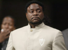 In a Sunday, Sept. 26, 2010 file photo, Bishop Eddie Long prepares to speak, at New Birth Missionary Baptist Church near Atlanta. Long, a prominent pastor who led one of metro Atlanta's largest churches, died Sunday, Jan. 15, 2017, the New Birth Missionary Baptist Church said in a statement to local media outlets.  He was 63.  (AP Photo/John Amis, Pool, File)