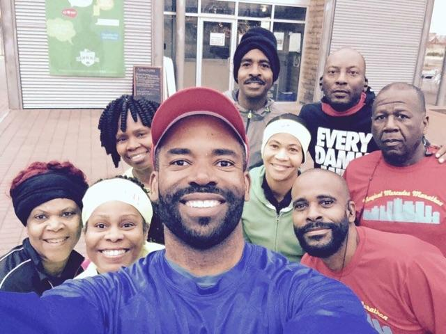 Eric Thomas takes a photo with a group of runners before their weekly workout. The group is part of Black People Run Bike and Swim, a group of diverse members that promote fitness activities for African-Americans. (Provided photos)