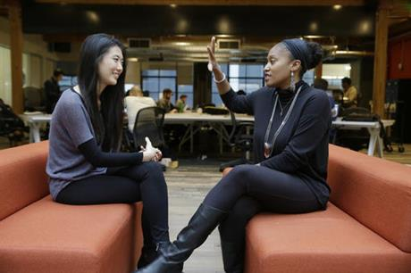 In this Tuesday, Jan. 3, 2017, photo, Aniyia Williams, founder and CEO of Tinsel, right, talks about program placement with Kara Lee, at the offices of Galvanize in San Francisco. Williams says she has made sure to hire women as well as underrepresented minorities. Tinsel makes tech jewelry targeted at women. (Eric Risberg, Associated Press)