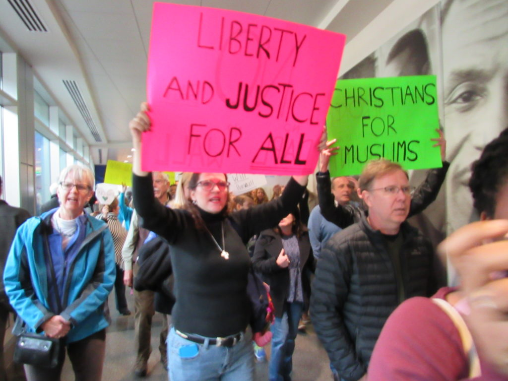 Potesters march through Birmingham-Shuttlesworth International Airport (Monique Jones, The Birmingham Times)