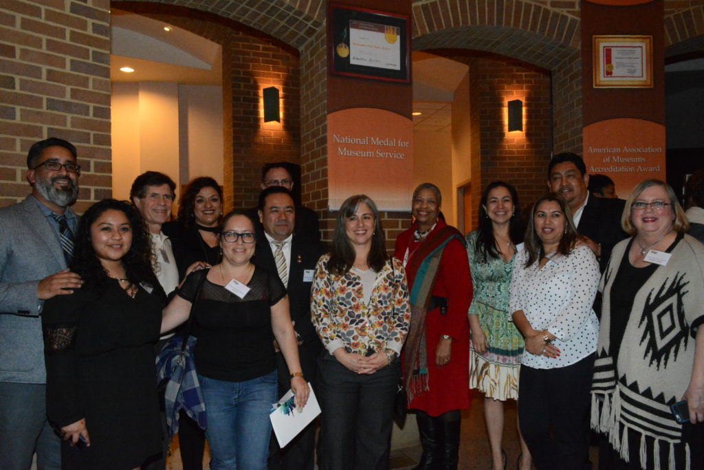 Nuevolution Advisory Committee From left: Carlos Aleman, Yasmin Contreras, Michael Wilson, Sarai Portillo, Michael Innis-Jimenez (back), John Ocampo, Isabel Rubio, Priscilla Hancock Cooper, Cinthia Saenz, Joel Rivera, Isabel Rivera, and Rosemary Johnson. Joel and Isabel Rivera are featured in the exhibition. (Stephonia Taylor McLinn, special to The Times).