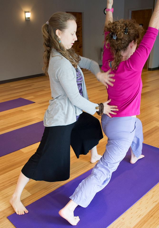 Lauren Rae Brown, yoga instructor at Embody Practice Center with client (provided photo)
