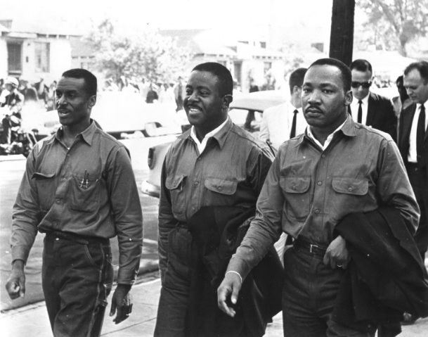 """From left: Rev. Fred Shuttlesworth, Rev. Ralph David Abernaththy, Rev. Dr. Martin Luther King defying an injunction against protesting on Good Friday in 1963. They were arrested and held in the Birmingham jail where King wrote his famous """"Letter From Birmingham Jail."""" (Birmingham Public Library)"""