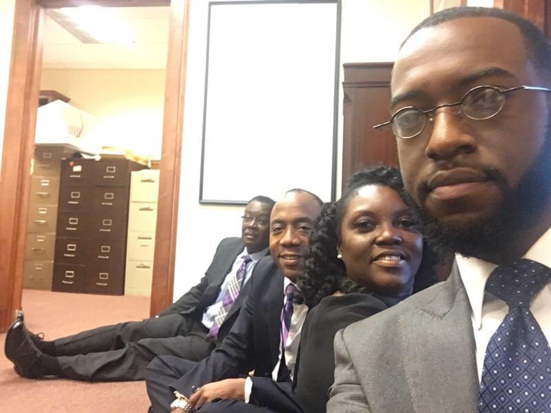 Alabama NAACP state conference President Bernard Simelton (far left) and NAACP National President/CEO Cornell William Brooks (center) were among the protesters who held a sit-in in Sen. Sessions' Mobile, Ala. office. (Twitter)