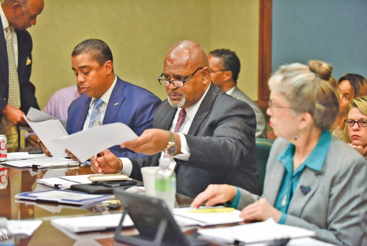 """Council members James """"Jay"""" Roberson, Steven W. Hoyt, and Valerie Abbott look over a handout from the mayor in August during the Birmingham City Council's Budget and Finance committee hearing. Municipal elections will take center stage in the city this year. (Frank Couch, special to The Times)"""