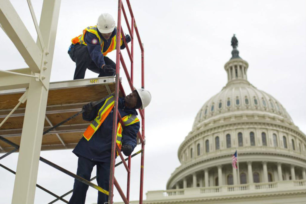 In this Dec. 8, 2016, file photo, construction continues for the Inauguration and swearing-in ceremonies for President-elect Donald Trump on the Capitol steps in Washington. (Pablo Martinez Monsivais, Associated Press)