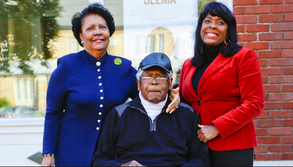 "Congresswoman Terry Sewell (right) with her dad Andrew ""Coach"" Sewell, former star athlete at ASU and head basketball coach at Selma High School and her mother Nancy Sewell, first African-American female member of Selma City Council. (Sewellforcongress.com)"