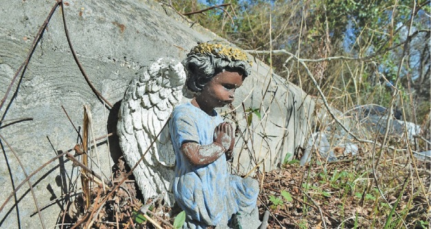 A small angel statue adorns a gravesite in the Chamberlin cemetery. (Provided photo)