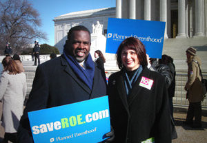 Rep. Albert Wynn (left) joins Gloria Feldt (right), President of the Planned Parenthood Federation of America, on the steps of the Supreme Court, to rally in support of the pro-choice movement on the Anniversary of Roe v. Wade. (Official website of US Congressman Albert Wynn/Public domain)