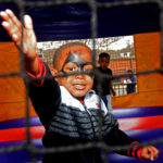 A youngster plays inside an inflatable dragon during the Victory Over Violence Tour event at Southtown Court on Saturday, Feb. 18, 2017. (Solomon Crenshaw Jr., for The Birmingham Times)