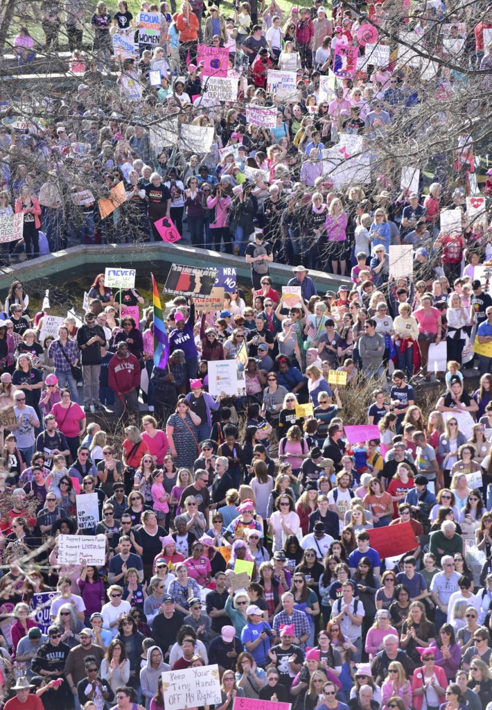 The crowd swelled as speakers rallied the crowd for over an hour. Thousands gathered in Kelly Ingram Park and marched in the Women's March Alabama Saturday January 21, 2017 in Birmingham, Alabama. They listened to speakers, sang, chanted and displayed signs before they marched from the to City Hall and back to the park arriving moments after the last of the marchers departed. (Frank Couch / The Birmingham Times)