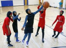 """In this June 16, 2015, file photo, East African Muslim girls practice basketball in their new uniforms in Minneapolis. International basketball competitions could have players wearing religious headgear including hijabs and yarmulkes soon. Leaders of basketball's governing body """"issued a mandate"""" at their recent meeting for its playing rules committee to come forward with a proposal for headgear to be worn safely by athletes in competition, with the goal of approving the change at its meeting in May. FIBA announced the decision earlier this week. (Jim Mone, Associated Press, File)"""