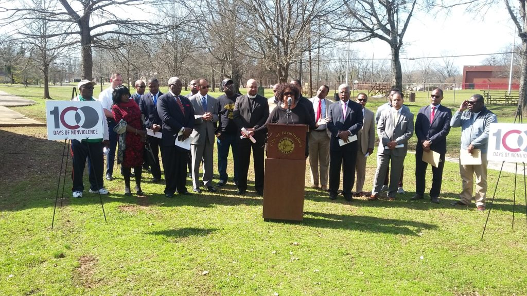 Jefferson County Commissioner Sandra Little Brown (at podium), with city, civic and community leaders, addresses the media during a press conference on steps planned to reduce violence in Birmingham. (Barnett Wright, The Birmingham Times)