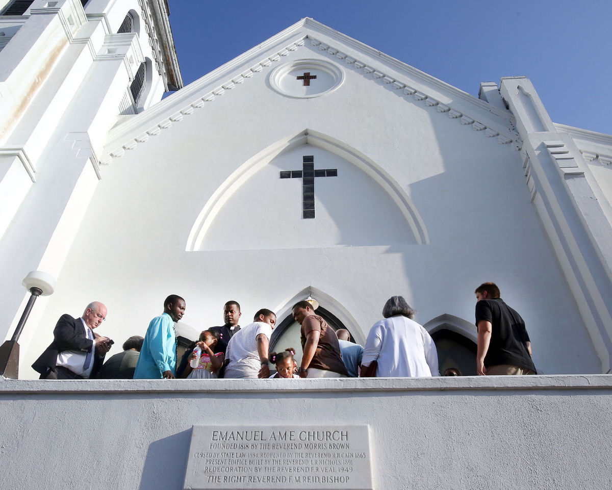 Worshipers wait for the doors at Emanuel AME Church to open Sunday morning for the first service after pastor and state Sen. Clementa Pinckney and eight others were slain during a Bible study by an avowed white supremacist. (Brad Nettles, Associated Press)