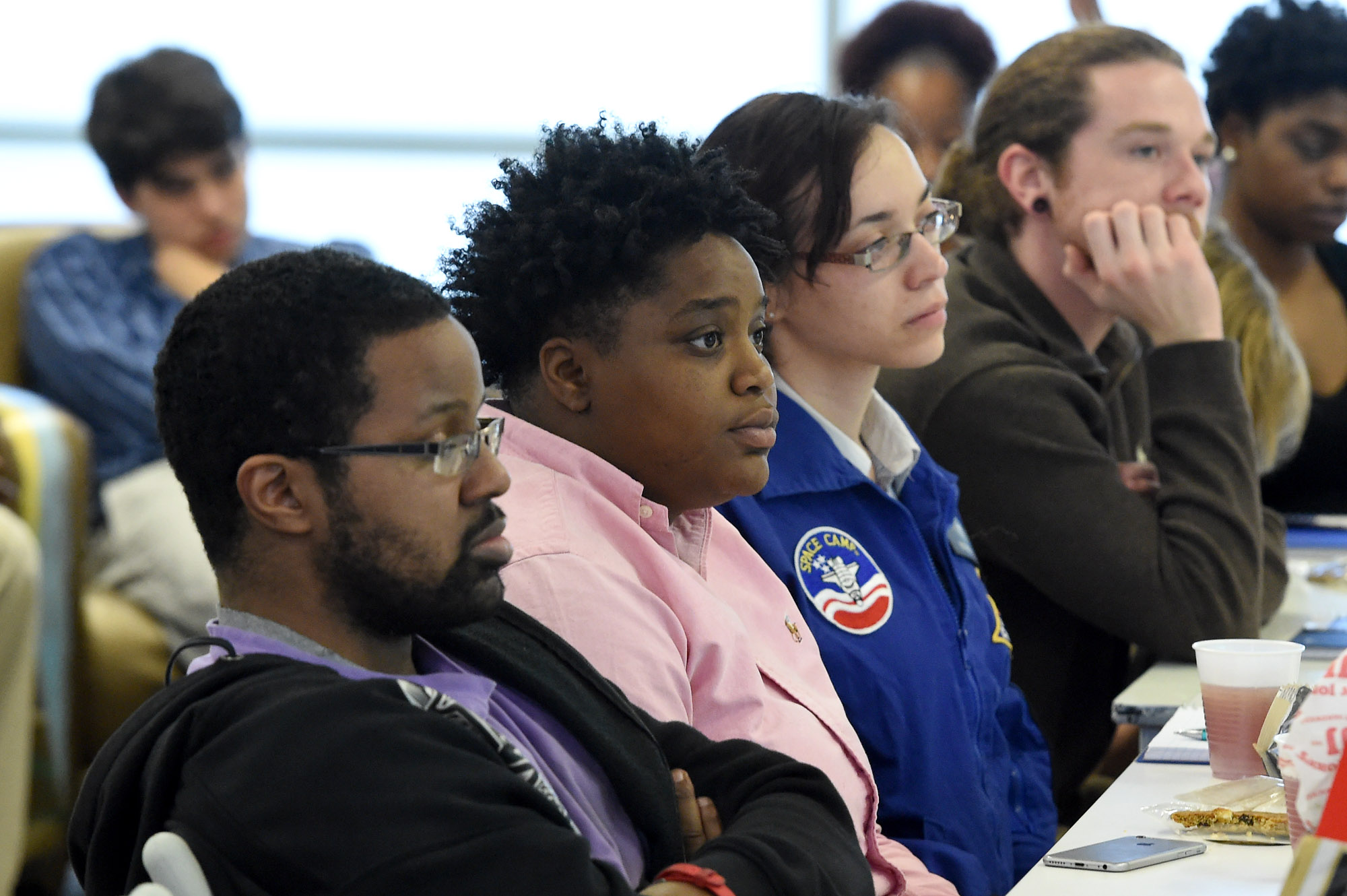 Students listen during a discussion about financial literacy as part of a partnership program to help students earn CompTIA A+ certification needed for entry-level jobs in the IT field at the Innovation Depot in Birmingham, Ala., Friday, Feb. 17, 2017. (Mark Almond, for The Birmingham Times)
