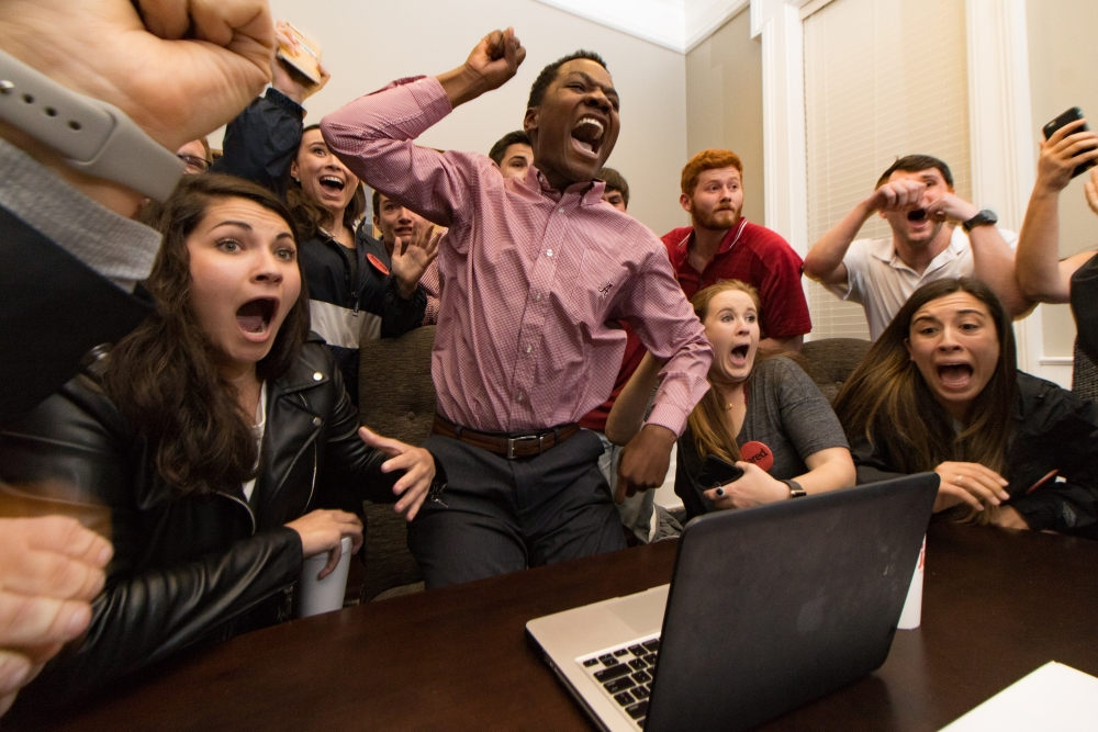 Jared Hunter, center, and his campaign staff react to his election as student body president at the University of Alabama in Tuscaloosa, Ala., on Tuesday, March 7, 2017. Originally from Wetumpka, Ala., Hunter is the first black student to win the position with the backing of a secretive group called The Machine, which is composed of the school's most prestigious, historically white fraternities and sororities (Jacob Arthur/Alabama Crimson White via AP)