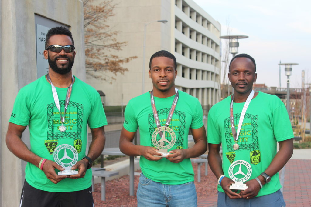 rom left: Eric Thomas, Walter McCord and Gideon Waithera holding their trophies from the Mercedes Marathon. (Ariel Worthy, The Birmingham Times)