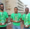 From left: Eric Thomas, Walter McCord and Gideon Waithera holding their trophies from the Mercedes Marathon. (Ariel Worthy, The Birmingham Times)