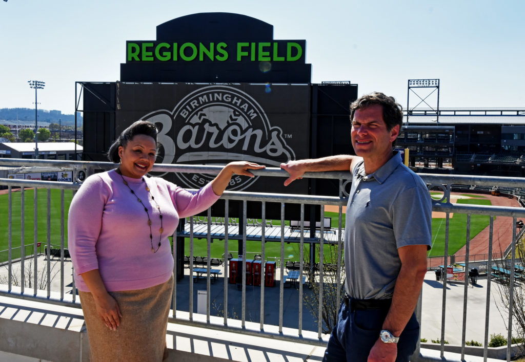 Natasha Rogers and Jonathan Nelson stand along the rooftop of the Negro Southern League Museum overlooking neighboring Regions Field. Rogers is executive director of the museum. Nelson is general manager of the Birmingham Barons, the minor league ballclub that plays at Regions Field. (Solomon Crenshaw Jr., for The Birmingham Times)