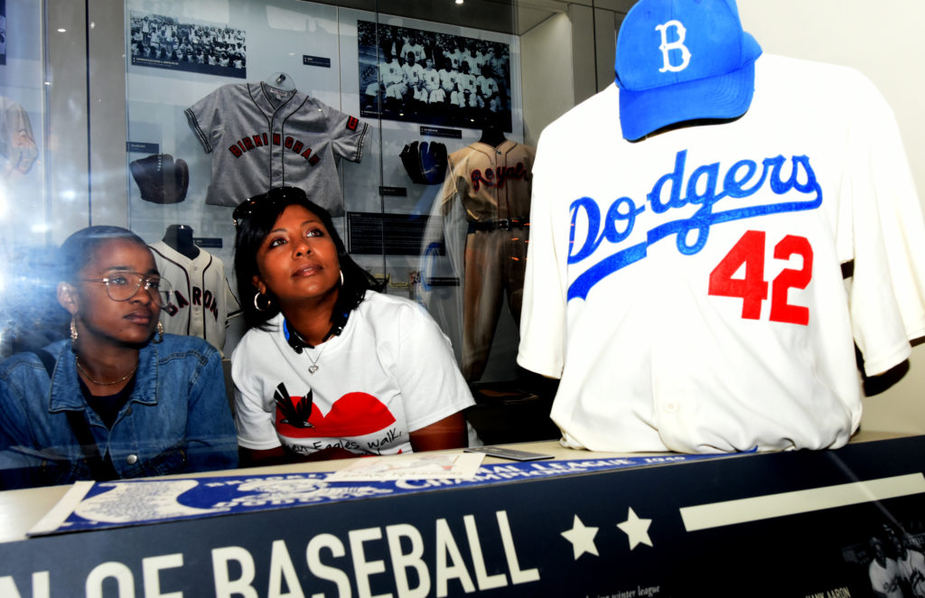 Chyna White, left, and her mother Charita Garcia-Jones look at the Jackie Robinson display at the Negro Southern League Museum. They were part of the 47-person Polk State College Upward Bound College tour group.