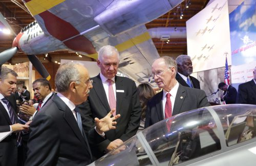 Governor Robert Bentley speaks with Leonardo President Filippo Bagnato, Leonardo DRS CEO Bill Lynn at the Leonardo DRS T-100 trainer jet announcement in Tuskegee, Ala.