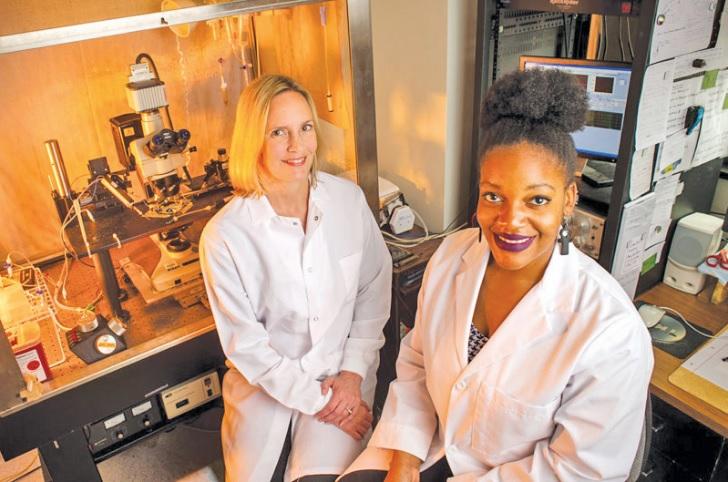 Each Roadmap Scholar works closely with a research mentor. Here, scholar Lillian Brady, right, meets with neurobiology associate professor Lynn Dobrunz. (Steve Wood, UAB News)