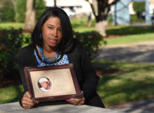Carolyn Johnson holds a picture of her son Rodreckus Johnson who was killed as he pulled up to a birthday party. He was shot as he parked and was hit by a bullet fired by two people arguing, his killer has never been arrested. (Frank Couch / The Birmingham Times)