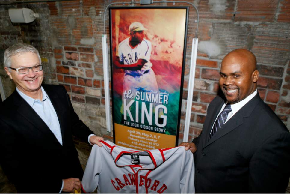Sean Gibson, the Executive Director of the Josh Gibson Foundation, right, holds a replica Pittsburgh Crawfords jersey with Pittsburgh Opera General Director Christopher Hahn. (Keith Srakocic, Associated Press)