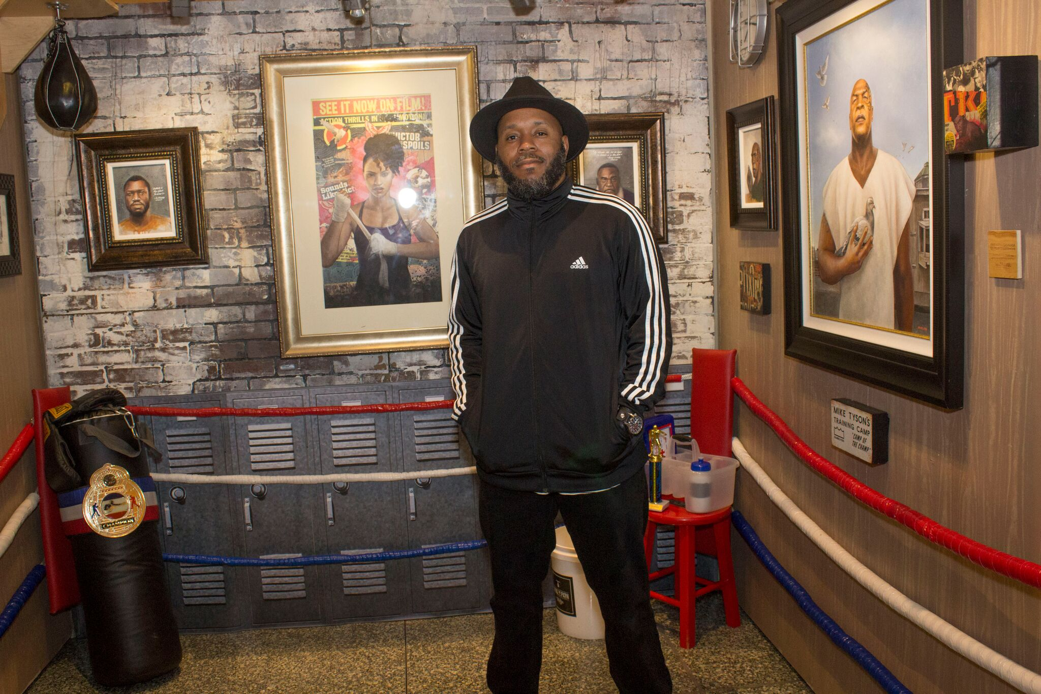 "Before opening the doors to the public ABL curator Dwight "" Dubelyoo"" Wright( pictured above) gave media a private tour of the premises. Wright stands in front of his own exhibit."