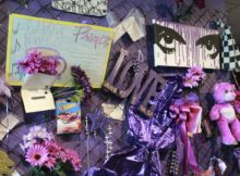 In this Nov. 2, 2016 photo, a replica of the Memorial Fence is shown at Prince's Paisley Park in Chanhassen, Minn. Paisley Park, home and studio of the late musician Prince, is open for public tours. Fans left memorials on Paisley Park after his death. (AP Photo/Jeff Baenen)