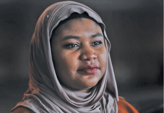 Fatimah Farooq counsels refugees from places like Iraq and Syria, who have been victims of trauma, torture or sex trafficking. (Paul Sancya, The Associated Press)