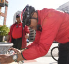 CAP officer Eugene McCoy removes graffiti from a trash can while on bike patrol. CAP has been a part of the resurgence of the downtown Birmingham area through their high visibility officers and assistance for businesses and citizens.  (Frank Couch, The Birmingham Times)