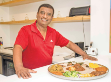 Amanshwa Takele is the owner of Ghion Cultural Hall. Takele, who also owns a Ghion location in Atlanta, said Ethiopian food is prepared healthier. (Reginald Allen, for The Birmingham Times)