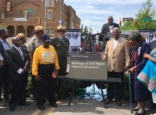 Bishop Calvin Woods (left) Mayor Bell (right) and footsoldiers of the Civil Rights Movement participate in the unveiling of the monument sign.  (Monique Jones, The Birmingham Times)