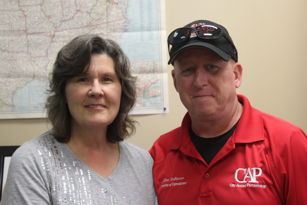 Mollie Hester (left),  manager at Travelers Aid Greater Birmingham with Glen Robinson, interim director, with City Action Partnership. (Ariel Worthy, The Birmingham Times)