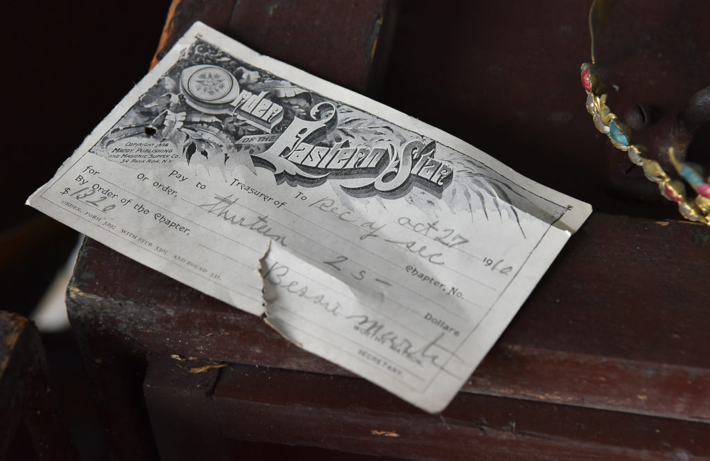 A receipt dated October 27, 1910, was found in the dilapidated hall. (Frank Couch, The Birmingham Times)