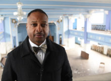 Corey Hawkins, Grand Master of the Most Worshipful Prince Hall Grand Lodge, Free and Accepted Masons of Alabama, stands on the balcony overlooking the grand ballroom (Frank Couch, The Birmingham Times)