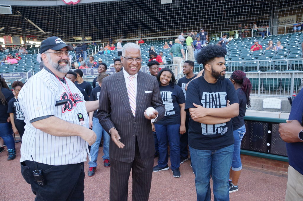 Don Lee, corporate sales Manager, Birmingham Barons; Mayor William Bell and DeZell Plump, choir director at Restoration Academy. (Provided photo)